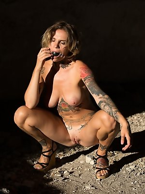 Stacy Cloud bares her lusty tattooed body as she poses in front of the camera.